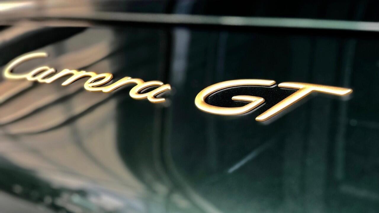 Porsche has restored a gorgeous green and gold Carrera GT